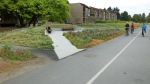 A more elaborate rest area, accessible to all. Note the pathway from the adjacent townhouse complex to the Greenway.