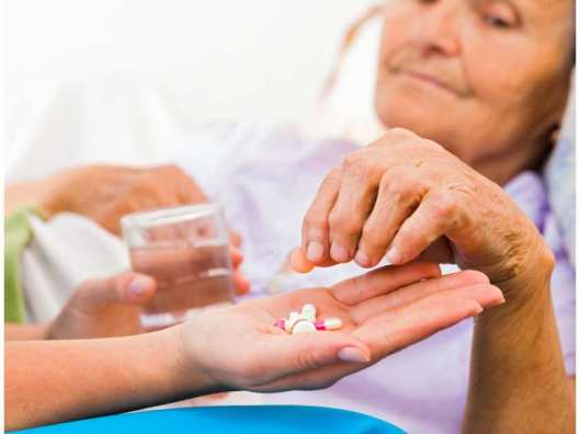 generic-pic-of-elderly-woman-being-given-pills-by-a-nurse-f