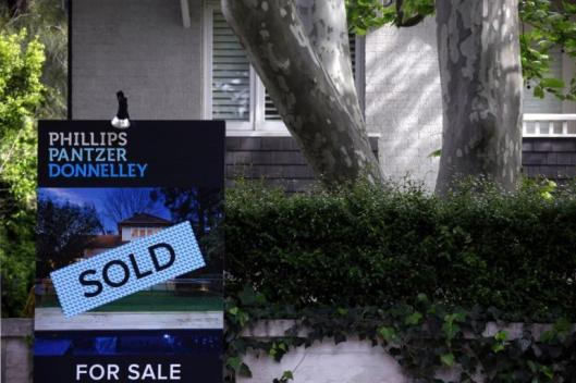 455235-a-real-estate-agents-sign-outside-a-house-shows-that-it-has-recently-b