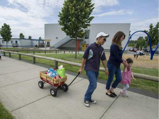 surrey-bc-june-12-2014-parents-walk-with-their-childre