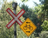 Crossing signage, old and new. Note the bell on top of the rairoad crossing sign.