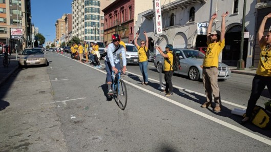 a-cyclist-greeted-by-a-bike-lane-protected-by-humans-on-golden-gate-all-photos-streetsblog-rudick